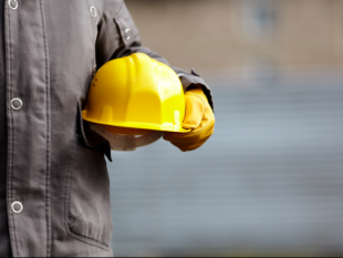 hard hat carried by worker