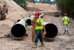 workers on pipeline