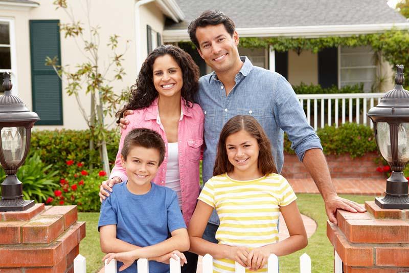 happy hispanic middle class family - dad mom kids