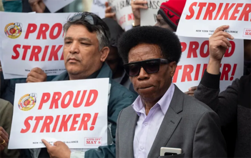 Drivers demand job security and livable incomes at a protest at Uber and Lyft's New York City headquarters in May 2019